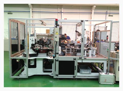 Máquina para fabricación y control de freno de mano para sector de Automoción